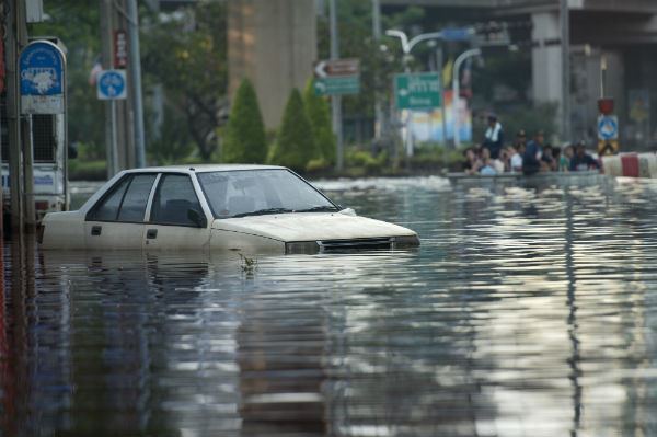 Car Surrounded By Flood Waters