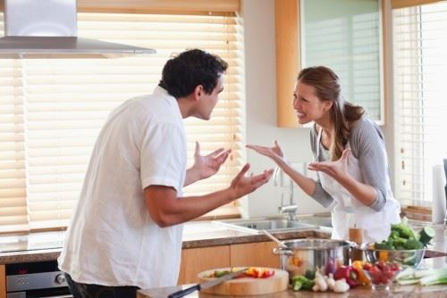 Mistakes We Make In Our Relationship: Couple Fighting in Kitchen