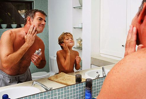 Father Son Applying Aftershave Cologne