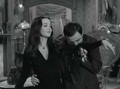 Romance and Chemistry on Screen: Gomez and Morticia Kiss