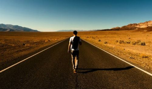 Man Walking Down Road Alone