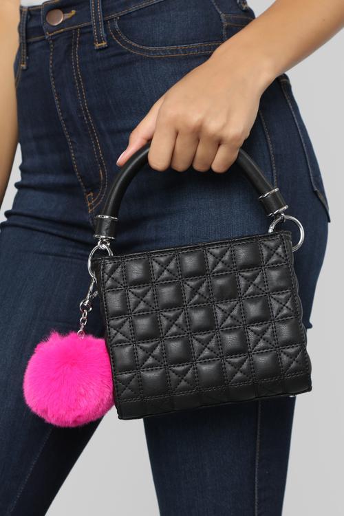 Woman holding hand bag